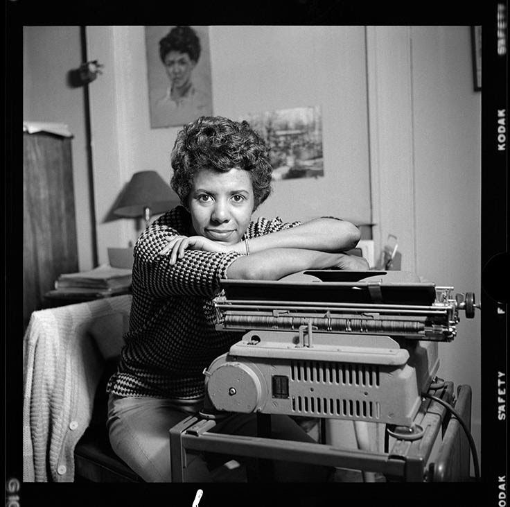 Lorraine Hansberry leans over her typewriter at her Greenwich Village apartment on Bleecker Street.